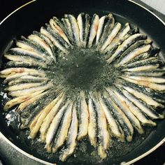 Cooking anchovies is a form of art in Turkey... #Travel # #Turkey #SerifYenen