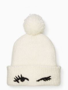 eyes up here  this adorable knit beanie is finished with a wink a95d12a2f68