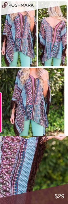 🎉SALE  🎉 Aztec Fringe Poncho Aztec Fringe Poncho with gorgeous purple and real colors. Leatherette fringe trim. This is a true poncho and can be worn as a top with a layering cami underneath.  Cami is NOT included. ONE SIZE FITS MOST!  Price is firm unless bundled 😉 I offer discounts on 2 or more items 😃 👍🏻  TK105833 2 a T Boutique  Tops