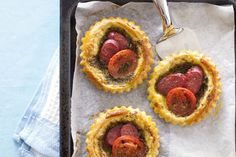 Chorizo tomato basil tarts recipe, NZ Womans Weekly – These tarts have a lovely zing to them the chorizo and tomato are a great combination - Eat Well (formerly Bite) Tomato Basil Tart, Basil Pesto, Nibbles For Party, Savoury Tarts, Chorizo Sausage, Tart Pan, Thing 1, Sliced Tomato, Tart Recipes