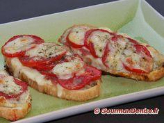 Bruschetta : 2/3 tranches de pain de campagne par personne, 1 pot de sauce tomate ou du concentré de tomate, 1 gousse d'ail, 2-3 tranches de jambon dégraissé, 1 boite de champignon, mozzarella, gruyère râpé allégé, persillade OU persil frais