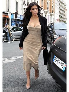 Kim Kardashian on the street in Paris | allure.com