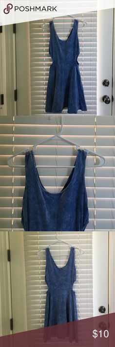 Super cute blue cutout dress Blue dress with cutout in upper hips, made to look like faded denim, size medium, fits like medium. Dress looks darker in first three pictures because of lighting. Last picture shows its color best Forever 21 Dresses Mini