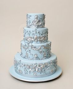 elegant winter wedding cakes with silver garnish