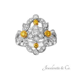 """Fancy Yellow Diamonds and White Diamonds """"Flowers and Ribbons"""" Ring."""