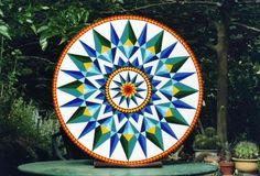 Triple Double Star Hex Sign, 48 inches diameter, by Kathy Dennett, Wing Canyon Vineyard. First sign to hang at Pearl Restaurant, above the bar.