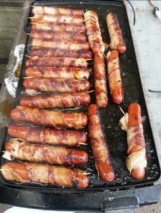 Bacon wrapped hot dogs cooked on the grill! Yummy! (The Man would LOVE this) - rugged-life.com