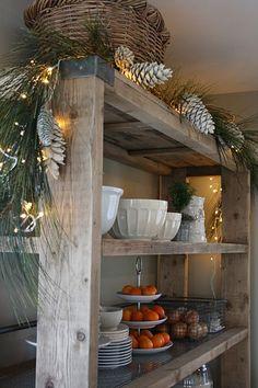 I like the Christmas decor, but I pinned this because I like the shelving =)