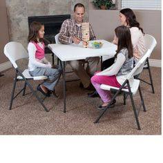 "Lifetime 34"" Square Card Tables - 80273 White Fold-in-Half Folding Table. This picture shows four people sitting."