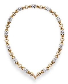 A DIAMOND AND GOLD NECKLACE, BY HARRY WINSTON   Designed as a band of circular and marquise-cut diamond and gold foliate clusters, spaced by openwork diamond circular links, mounted in 18k gold and platinum, circa 1978, 21¾ ins., (with pendant hoop for suspension)  With maker's mark for Harry Winston