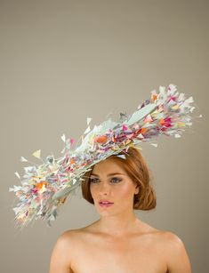 a66c13aafb30a The Buckingham dish hat comprises a large double layered sinamay base  adorned with a beautiful array of cut coque feathers between the two layers