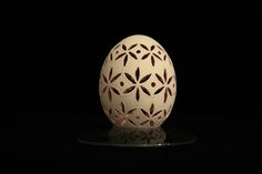 This egg is part of a series that I'm calling starflower. The eggs are first dyed inside by squirting dye inside the hole with a syringe and shaking it. For this egg, the dye was orchid. After the dye. Carved Eggs, Egg Art, Carving Tools, Three Dimensional, Orchids, Wax, Beautiful, Design, Eggs