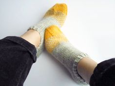 Ombré slipper socks in grey and yellow hand knit bed by Mairea