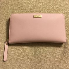 """Kate Spade Newbury Lane Wallet Beautiful wallet! Color is """"ballet slipper"""".... Good condition but has been used. kate spade Bags Wallets"""
