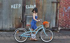 Young Girl Rides A Beach Cruiser Bicycle (c)Hannah Mason/Corbis