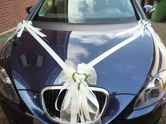 Wedding Car Decoration With White Ribbon And Small Flowers Hochzeitsauto-Dekoration mit weißem Band und kleinen Blumen Wedding Car Decorations, Wedding Table Centerpieces, Wedding Photo Walls, Bridal Car, Wedding Bows, White Ribbon, Small Flowers, Most Beautiful Pictures, Weddings