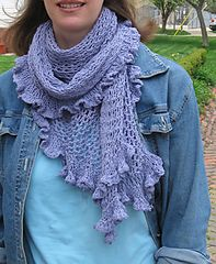 This shawl does double duty, either as a lightweight wrap or, looped around your neck a couple of times, a surprisingly warm scarf. Although I really like the drape and swoosh of the Taj Mahal yarn shown, you could work this in virtually any yarn you like. The pattern is very simple, and since it can be worked to any size, gauge doesn't really matter.