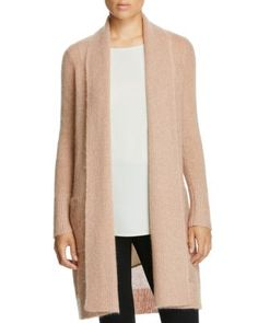 Designed in a pretty-in-pink knit with a cozy shawl collar, Eileen Fisher's…