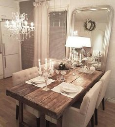 I almost have no words for this. the combo of the chunky wood table with the chandelier and fabric chairs. looks great.