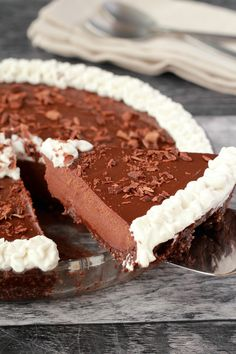 Vegan Chocolate Pie in a glass dish with napkins and cutlery in the background.