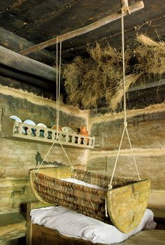 I'd love to have this.  Reminds me of where we grew up (Russia) Love the hanging moses basket. Cute for the livingroom I think.