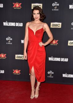'The Walking Dead' Season 5 Premiere Lauren Cohan plays Maggie Greene on the zombie drama, but she's a lady in red on the premiere carpet, wearing a plunging, bright red draped dress.