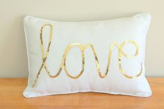 Gold Sequined Love Cushion - this would be a super simple DIY! Just buy a plain pillow and glue on sequin trim in whatever shape or word you want!