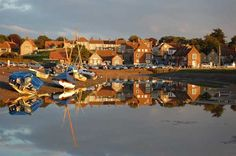 Blakeney is a pretty village on the North Norfolk coast Norfolk Broads, Norfolk Coast, British Countryside, Picture Postcards, Window Cleaner, Blue Skies, Ancestry, Great Places, Boats