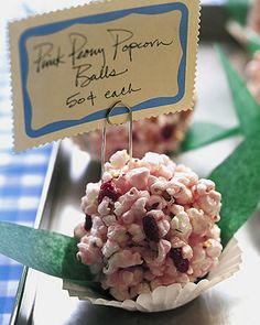 Pink Peony Popcorn Balls - Martha Stewart Recipes12 cups popped, unsalted popcorn (1/2 cup kernels)  1/2 cup sun-dried cranberries  1 1/3 cups sugar  5 tablespoons light corn syrup  1/4 teaspoon salt  1/2 teaspoon white vinegar  1 or 2 drops red food coloring