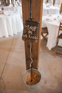 Add surprising elements to give your wedding some flair. We love this rustic bell to call for the newlyweds to kiss. From #BridalGuide #NewlywedIdeas #RusticWedding