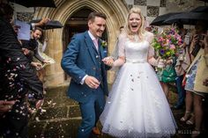 Stunning real bride, Abi, in her custom Claire dress from House of Mooshki in ivory, calf length. Polkadot lace wedding dress. Vintage style wedding dress.