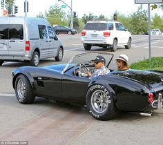 Lewis Hamilton & Nicole Sherzinger in a Shelby Cobra 427 Super Snake. Not exactly a Maserati... but close enough right?