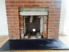 Before: A gas fire was removed from the fireplace, but the opening still needed to be enlarged to be able to install an inset Clearview Stove. #gas #fire #stove #removal #fireplace #inset #clearview #building #construction #work #kernowfires #wadebridge #redruth #cornwall