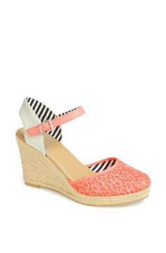 Adore the electric touch of coral on this DV sandal.