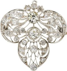 Edwardian Diamond, Platinum Brooch The brooch features European-cut diamonds weighing a total of approximately 2.70 carats, set in openwork platinum, completed by a pendant bail, pinstem and catch on the reverse.