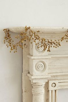 Décor around the fireplace. gilded holly jingle bell garland