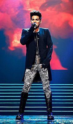 Adam Lambert mm love the coat and pants and the boots. Moschino pants