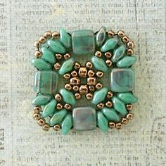 I bought this bracelet pattern recently and thought I'd look through my CzechMates tile beads and come up with a few color combinations. I t...