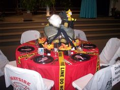 I like the idea of shirts as chair covers and black plates w/ ribbon Fireman Wedding, Fireman Party, Firefighter Wedding, Firefighter Birthday, Bear Wedding, Firefighter Crafts, Firefighter Paramedic, Retirement Party Decorations, Retirement Parties