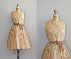 Golden lace gown with caramel bow.  For someone with a tiny waist... so beautiful.