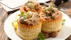 Chicken& Mushroom Filling   2 each   Chicken Breast 200-220g  100g       Wild Mushroom cut into medium pieces  2 tbsp    Olive Oil  2 x 75g  Butter  2 tbsp.   Plain Flour  350ml    Water  1 pot       Chicken Bouillon  150ml    Double Cream  1/4 tsp.  Rosemary Finely chopped  2 tbsp.   White Onion Finely Chopped  1/2 clove               Garlic  125ml    White Wine  2 Tbsp.  Chives Chopped  Cracked Black pepper & Salt  Parsley Sprigs to Garnish