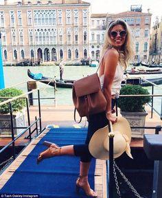 Soaking up the sights: Model Natasha Oakley took in the sights of Venice as she explored the romantic Italian city by gondola