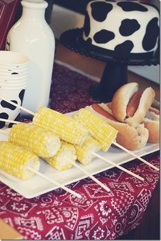 "hot dogs & corn - great ""farm food"" (And I love the cow print cake in the back - too cute!)"