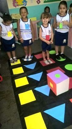 Fun and engaging way to learning shapes. Use gross motor skills to hop and jump as the shapes are rolled and see which shape wins. Gross Motor Activities, Preschool Learning Activities, Preschool Classroom, Educational Activities, Classroom Activities, Preschool Activities, Teaching Kids, Kids Learning, Movement Activities