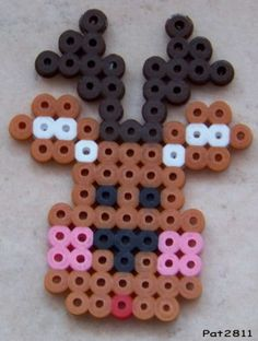 Christmas reindeer hama perler beads by Les loisirs de Pat Perler Bead Designs, Hama Beads Design, Melty Bead Patterns, Hama Beads Patterns, Beading Patterns, Christmas Perler Beads, Beaded Christmas Ornaments, Christmas Crafts For Kids, Xmas Crafts