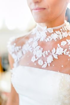A floral neckline: http://www.stylemepretty.com/australia-weddings/2015/10/30/look-we-love-floral-wedding-dress-details/
