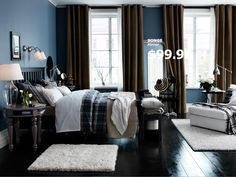 Bedroom With Blue slate walls and Brown and white accents.  Elegant in a way
