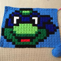 Leonardo TMNT pixel crochet floor cushion (front) by madamme27