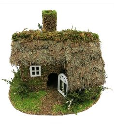 Lifelike and unique, the Bloom Room Littles Fairy Garden Grass And Moss Roof House will make any miniature garden look magical. This lovely miniature house is designed with lots of grass and dried mos