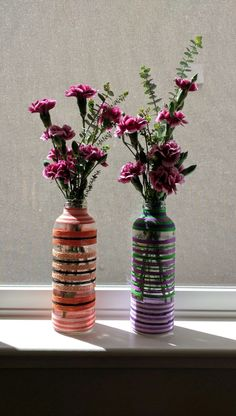 A simple Diy flower vase i did using colorful yarn and mod podge!! Decorating with flowers brought more beauty to them..